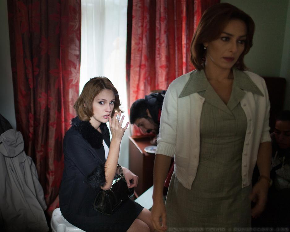"""Actress Ayça Bingöl (Cemile Akarsu in the film - in white) and Farah Zeynep Abdullah (Aylin Akarsu in film - in black).<br /> <br /> In Istanbul, Turkey, during the shooting of the 46th episode of Öyle Bir Geçer Zaman Ki (""""As Time goes by""""), a very popular Turkish drama television series broadcast by Kanal D and produced by Productions D.<br /> The series got many awards and broke several viewer records with a continous weekly market share of 50- 60 % and an average of 25- 30 million viewers each week in Turkey and more in the Turkish migration countries.<br /> Such drama series have become pop-culture phenomenon abroad, especially in the Arab world, Eastern Europe, Middle East but also all across Africa. By way of highlighting aspects of Turkish lifestyle, they have an increasing geopolitical impact on the region.<br /> In Saudi Arabia, Gumus's final episode (a popular Turkish melodrama) attracted a record 85 million Arab viewers when it aired in Aug. 30 2011."""