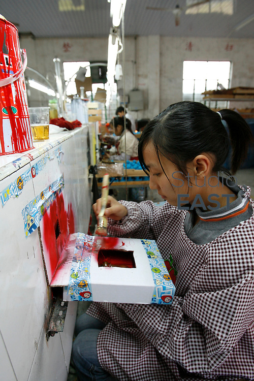 FENGXIANG, CHINA - October 30: A worker paints toy plastic figures, in a factory on October 30, 2008 in Fengxiang, near Shanghai, China. Although Chinese authorities predict that 2009 will be a tough year, they are ready to do all that takes to keep China's growth ''around 8%''. Beijing government announced a 450 billion Euros investment plan until 2010 to boost Chinese economy. ''We could take new measures (...) to prevent any economical downturn'' said Premier Wen Jiabao in Davos 2009 economy forum. (Photo by Lucas Schifres/Getty Images)