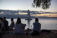 Travelers enjoy the waterfront view at sunset from Rex Smeal Park in Port Douglas, Australia