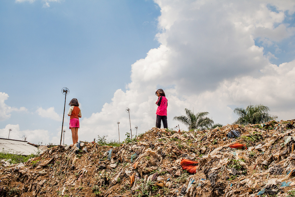 Children plays on the bank of the Citarum River.  Citeureup Village, Kabupaten Bandung...Credit: Andri Tambunan for Greenpeace