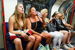 © Licensed to London News Pictures. 20/07/2016. London, UK. People drink water to stay cool whilst traveling on the tube in central London when temperatures hit 27C degrees across the capital on Wednesday, 20 July 2016. Photo credit: Tolga Akmen/LNP