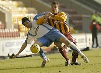 Photo: Aidan Ellis.<br /> Bradford City v Swindon Town. Coca Cola League 1. 11/02/2006.<br /> Swindon's Lee Peacock battles with Bradford's Lewis Emanuel