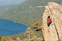 Young man bouldering on Donner Summit, CA