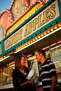 A couple eats cotton candy at the South Carolina Coastal Fair in Charleston, SC.
