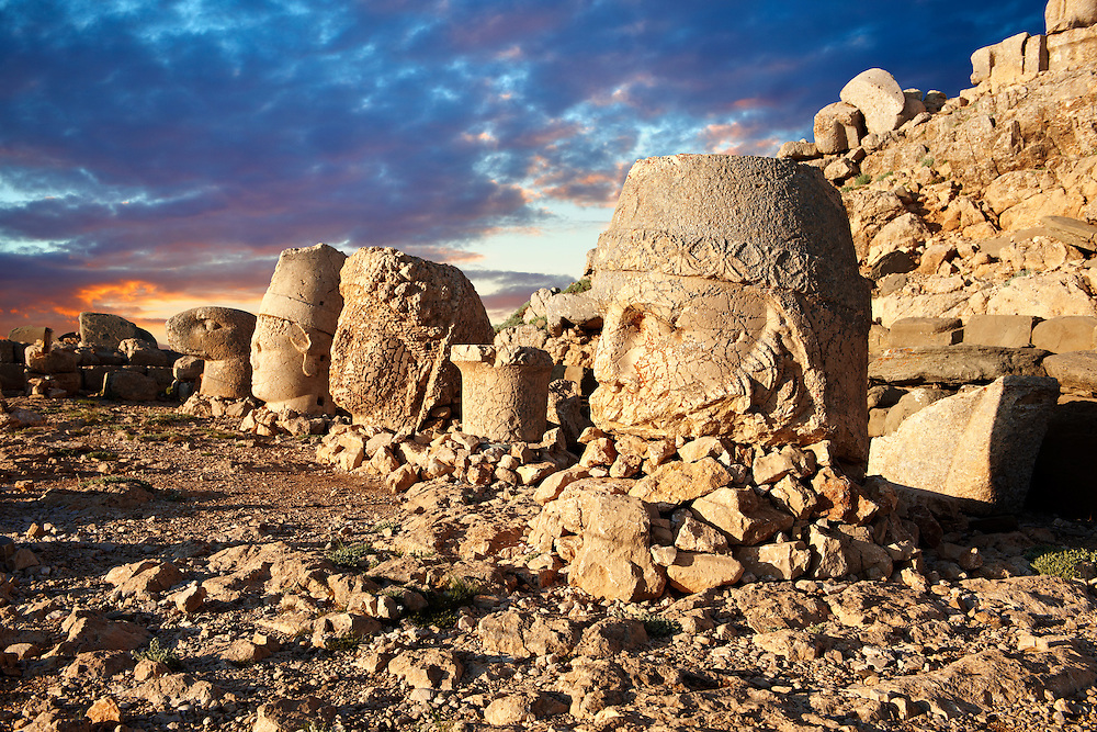 Image of the statues of around the tomb of Commagene King Antochus 1 on the top of Mount Nemrut, Turkey. Stock photos & Photo art prints. In 62 BC, King Antiochus I Theos of Commagene built on the mountain top a tomb-sanctuary flanked by huge statues (8–9 m/26–30 ft high) of himself, two lions, two eagles and various Greek, Armenian, and Iranian gods. The photos show the broken statues on the  2,134m (7,001ft)  mountain. 4 .<br /> <br /> If you prefer to buy from our ALAMY PHOTO LIBRARY  Collection visit : https://www.alamy.com/portfolio/paul-williams-funkystock/nemrutdagiancientstatues-turkey.html<br /> <br /> Visit our CLASSICAL WORLD HISTORIC SITES PHOTO COLLECTIONS for more photos to download or buy as wall art prints https://funkystock.photoshelter.com/gallery-collection/Classical-Era-Historic-Sites-Archaeological-Sites-Pictures-Images/C0000g4bSGiDL9rw
