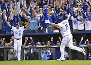 Oct 9, 2015; Kansas City, MO, USA; Kansas City Royals designated hitter Kendrys Morales (25) reacts after hitting a home run against the Houston Astros in game five of the ALDS at Kauffman Stadium. Mandatory Credit: Peter G. Aiken-USA TODAY Sports