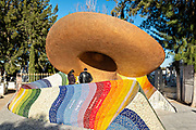 Mausoleum of Jose Alfredo Jimenez in the shape of a traditional Mexican hat and shawl at the Panteon Municipal in Dolores Hidalgo, Guanajuato, Mexico. Jimenez was a famous Mexican singer and father of the modern rancheras genre.