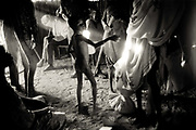 A boy pleads for more food in a grain store in an emergency feeding centre in Ajiep, South Sudan