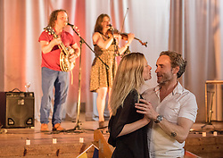 Pictured: Shauna Macdonald and Cal MacAninch dancing to music by Jo and Jed <br /> <br /> The community in Portobello came out last night in support of a locally organised campaign to try and save a local church and its attached church hall for the community. No longer needed by the church, who plan to sell it, the hall is widely used by community groups. The campaign hopes to make use of Scottish community buy-out legislation that has recently been extended to cover urban areas in one fo the first such campaigns in a Scottish urban area. Local film acting couple, Shauna Macdonald and Cal MacAninch, were instrumental in the event that featured a variety of local talent and was attended by about 150 people, packing out the church hall. Shauna brought the show together, along with her sister Kyrsta, and Cal performed on stage in both the specially written short play that opened the evening and singing with the band Hooseband at the show's finale.  <br /> <br /> <br /> © Jon Davey/ EEm