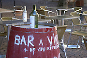 A wine bar. Barrel with bottle advertising. Place Saint Pierre. Bordeaux city, Aquitaine, Gironde, France