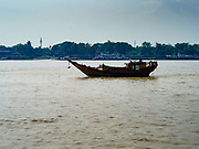 20 NOVEMBER 2017 - YANGON, MYANMAR: A boat on the Yangon river. Tens of thousands of commuters ride the ferry every day. It brings workers into Yangon from Dala, a working class community across the river from Yangon. A bridge is being built across the river, downstream from the ferry to make it easier for commuters to get into the city.     PHOTO BY JACK KURTZ