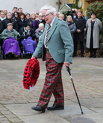 Veteran Peter Knowles from the Royal Army Service Corps lays a wreath on behalf of the Erskine Veterans during a Service of Remembrance on Armistice Day at Erskine Home in Bishopton, Scotland.