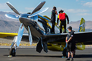 Thom Richard and his crew chief, Phil Evenden, go over the flight plan before a heat at the 2015 Reno Air Races.