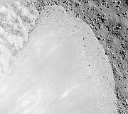 Debris flow extending down the southwest wall of Janssen K crater.
