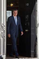 © licensed to London News Pictures. London, UK 26/07/2012. US presidential candidate Mitt Romney leaving No 10 in  Downing Street on 26/07/12. Photo credit: Tolga Akmen/LNP