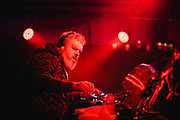 Kristian Nairn in the middle of a DJ set at Edinburgh's Potterrow.