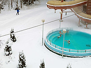 Four men relax in a heated swimming pool during the Winter at Spa Hotel Rauhalahti, Kuopio, Central Finland.