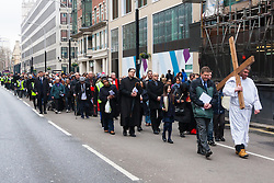 Hundreds of Christians in London take part in the interdenominational Methodist, Anglican and Catholic March of Witness in Westminster. PICTURED: Scores of Christians walk in a solemn procession along Victoria Street towards Westminster Cathedral