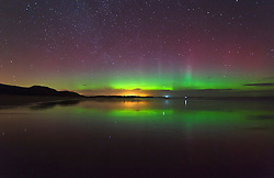 FILE PICTURE © Licensed to London News Pictures. 22/01/2012. London, UK. Aurora seen at Embleton Bay in Northumberland, UK, on the evening of 22 January 2012. The Aurora Borealis, known as The Northern Lights, which normally appear above Iceland and Norway, were seen further south this weekend due to unusual solar activity. Photo credit : Mike Ridley/LNP