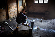A migrants is seen performing ablutions in one of the abandoned wearhouse where about 900 migrants now lives. March 17th, 2017, Belgrade, Serbia. Federico Scoppa
