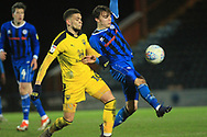 Ollie Rathbone wins a challenge during the EFL Sky Bet League 1 match between Rochdale and Oxford United at Spotland, Rochdale, England on 12 March 2019.
