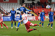 Carlisle United defender George Tanner (2) and Stevenage forward Luke Norris (36) battles for possession during the EFL Sky Bet League 2 match between Stevenage and Carlisle United at the Lamex Stadium, Stevenage, England on 20 March 2021.