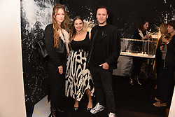 Left to right, Liza Urla, Eva Fehren and Nicholas Kirkwood at a party hosted by Nicholas Kirkwood and Eva Fehren to celebrate Part 2 in the Nicholas Kirkwood presents series held at Nicholas Kirkwood, 5 Mount Street, London England. Eva Fehren is a fine jeweller, born and raised in New York City. Her collections are both inspired and created in the city, and via the Nicholas Kirkwood store, it is the first opportunity to view and shop the collection in London. 9 November 2017.