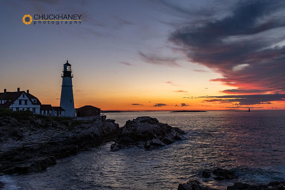 Amazing sunrise clouds at Portland Head Lighthouse in Portland, Maine, USA
