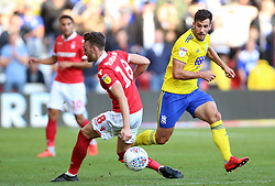 Nottingham Forest's Jack Robinson (left) and Birmingham City's Maxime Colin battle for the ball