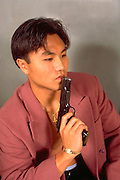 Korean American age 22 participating in target practice with 45 colt pistol MR.  St Paul Minnesota USA
