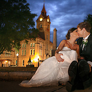 A newly married couple kisses for a portrait near the Newberry Opera House in Newberry. ©Travis Bell Photography