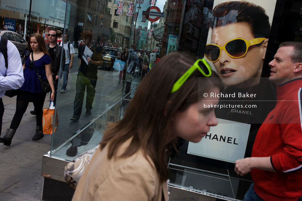 Passers-by and the Chanel sunglasses shop in central London's Covent Garden.