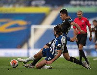 Manchester City's Rodrigo (right) is tackled by Brighton & Hove Albion's Davy Propper (left) <br /> <br /> Photographer David Horton/CameraSport<br /> <br /> The Premier League - Brighton & Hove Albion v Manchester City - Saturday 11th July 2020 - The Amex Stadium - Brighton<br /> <br /> World Copyright © 2020 CameraSport. All rights reserved. 43 Linden Ave. Countesthorpe. Leicester. England. LE8 5PG - Tel: +44 (0) 116 277 4147 - admin@camerasport.com - www.camerasport.com