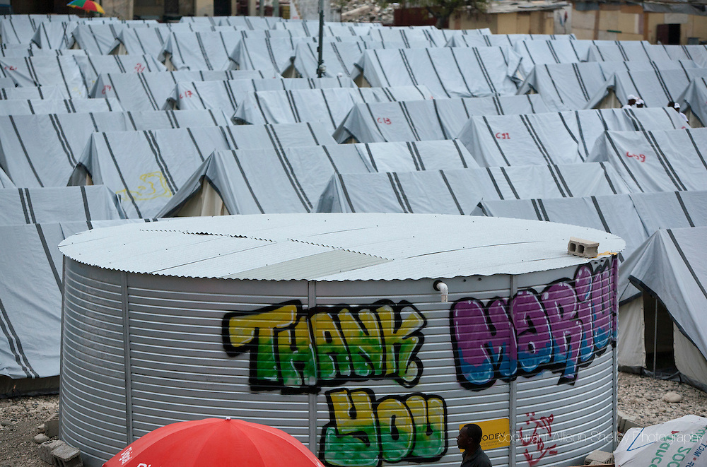 A water tank in a tent camp behind the Notre Dame de l'Assomption Catholic church sports a message from its inhabitants, in Port au Prince, Haiti, Friday, February 26, 2010.