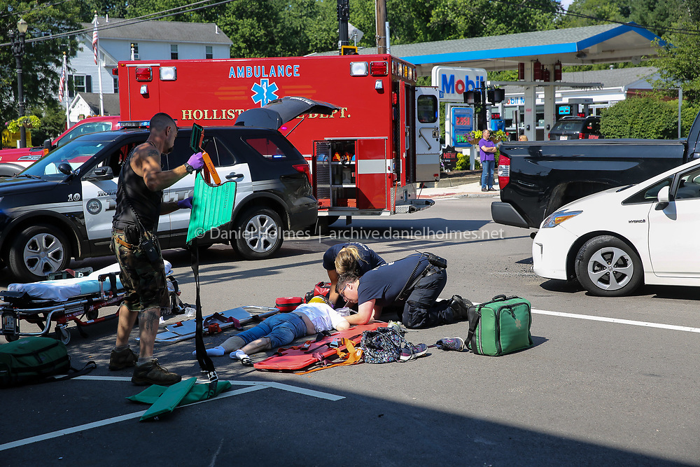 (7/13/19, HOLLISTON, MA) First responders stabilize an elderly woman that was purportedly struck by a vehicle shortly before 10 a.m. in front of 798 Washington St in Holliston on Saturday. A medical helicopter was called but cancelled, and the patient was transported to Milford Regional Medical Center. [Daily News and Wicked Local Photo/Dan Holmes]