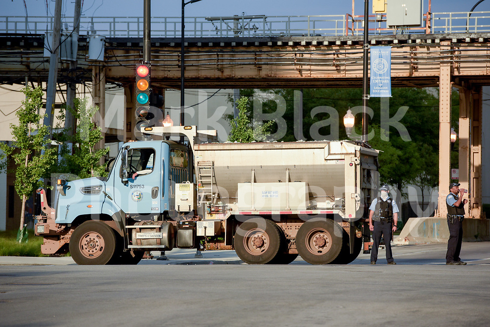 The Chicago Police Department use Department of Streets and Sanitation to barricade 35th Street at State Street in Chicago on Saturday, Aug. 15, 2020. Photo by Mark Black