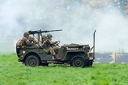 Re-enactors portrayiing members of the 82nd Airborne Division enter a battle battle re-enactment in Willys Jeeps on Pickering Showground<br /> <br /> 17/18 October 2015<br />  Image © Paul David Drabble <br />  www.pauldaviddrabble.co.uk