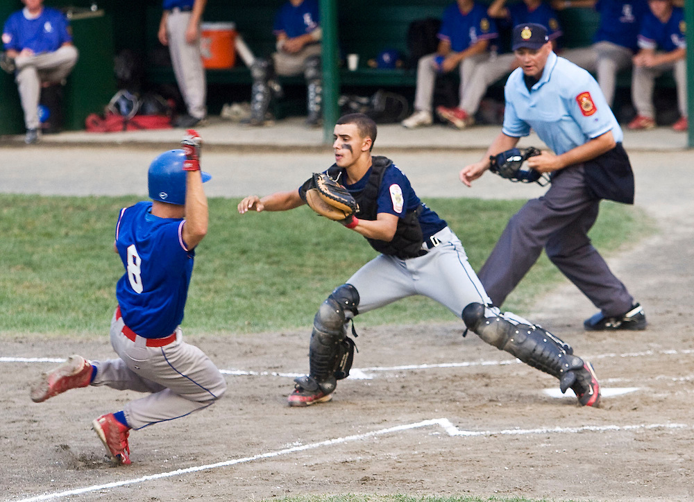 MIDDLETOWN, CT - 09 AUGUST 2010 -.East Longmeadow Post 293's Frank Calabrese scores the teams first and only run as Branford Post 83's Buddy Shea waits for a throw during Monday's American Legion Northeast Regional Tournament Championship game at Palmer Field in Middletown. East Longmeadow lost, 2-1..Photo by Josalee Thrift