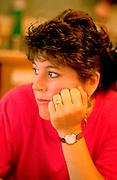 Woman age 29 with hand on chin thinking.  St Paul  Minnesota USA