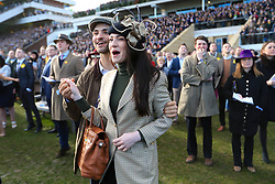 Racegoers watch the Sun Bets Stayers Hurdle Race during St Patrick's Thursday of the 2018 Cheltenham Festival at Cheltenham Racecourse.