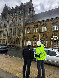 © London News Pictures. 02/03/2016. Aberystwyth, UK. <br /> Damage to the roof of the Ceredigion Museum in Aberystwyth being inspected as Storm Jake hits the Welsh coastline.  70mph gusts of wind have torn roof-slates off several of the older properties on seafront and brought down trees in the town centre. Photo credit: Keith Morris/LNP