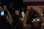 First Lady Michelle Obama greets a crowd of Mark Udall supporters at a Udall senate reelection campaign visit in Denver, Thursday, Oct 23, 2014. Obama visited Denver in hopes of turning a difficult senate race in Udall's favor.