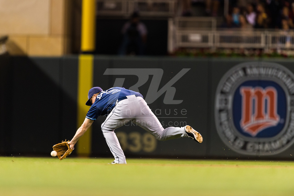 Elliot Johnson (9) of the Tampa Bay Rays misses a ground ball during a game against the Minnesota Twins on August 10, 2012 at Target Field in Minneapolis, Minnesota.  The Rays defeated the Twins 12 to 6.  Photo: Ben Krause
