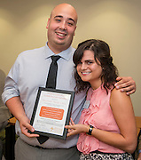 Rick Cruz, left, is presented the Pitzer College Core Values Award by Mattie Ross, right, September 19, 2014.