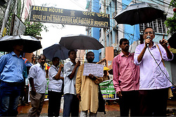 July 31, 2018 - Kolkata, India - Activists of the Amra Bengali  shout slogans against the Assam chief Minister Sarbananda Sonowal and burn effigy   during a protest rally following the publishing of the first complete draft of the National Register of Citizens (NRC), in Front of Assam house Kolkata on July 31, 2018. India. (Credit Image: © Debajyoti Chakraborty/NurPhoto via ZUMA Press)