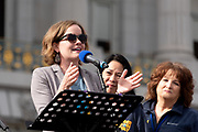 San Francisco, USA. 19th January, 2019. The Women's March San Francisco begins with a rally at Civic Center Plaza in front of City Hall. Becky Gulvig, currently starring in the national tour of COME FROM AWAY, treats the audience to a song from the production now playing in San Francisco. Credit: Shelly Rivoli/Alamy Live News
