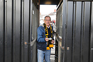 a Newport Fan arrives through the turnstiles ahead of the game. The Emirates FA Cup, 2nd round match, Newport County v Cambridge United at Rodney Parade in Newport, South Wales on Sunday 3rd December 2017.<br /> pic by Andrew Orchard,  Andrew Orchard sports photography.