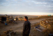 Hopi High School boys cross-country assistant coach Juwan Nuvayokva  prepares for a morning run at his childhood home in the Hopi village of Oraibi in northern Arizona on October 23, 2015. Nuvayokva ran on the team while he was in school, which has won 25 consecutive state titles under coach Rick Baker, who started the program. Much of the team's success is owed to a deeply rooted culture of running, which the Hopi believe is a source of physical and spiritual strength.