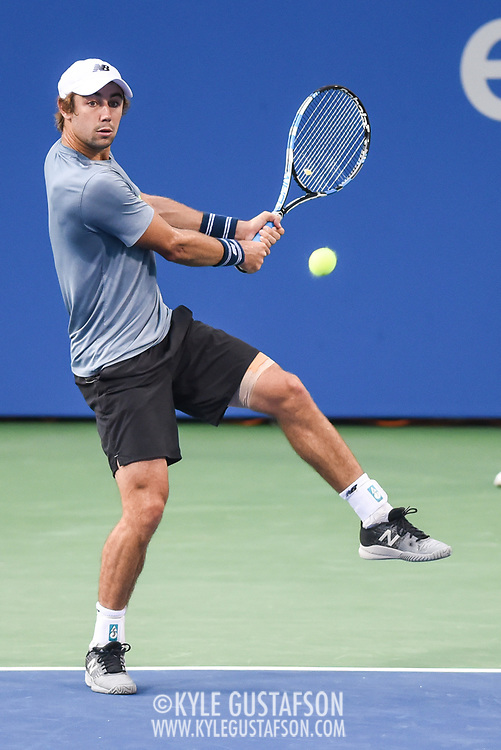 JORDAN THOMPSON hits a backhand during his second round match at the Citi Open at the Rock Creek Park Tennis Center in Washington, D.C.