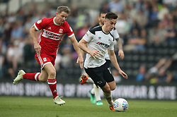 Derby County's Tom Lawrence and Middlesbrough's Grant Leadbitter (left)